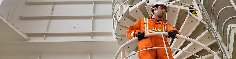 a shell employee on stairs with uniform
