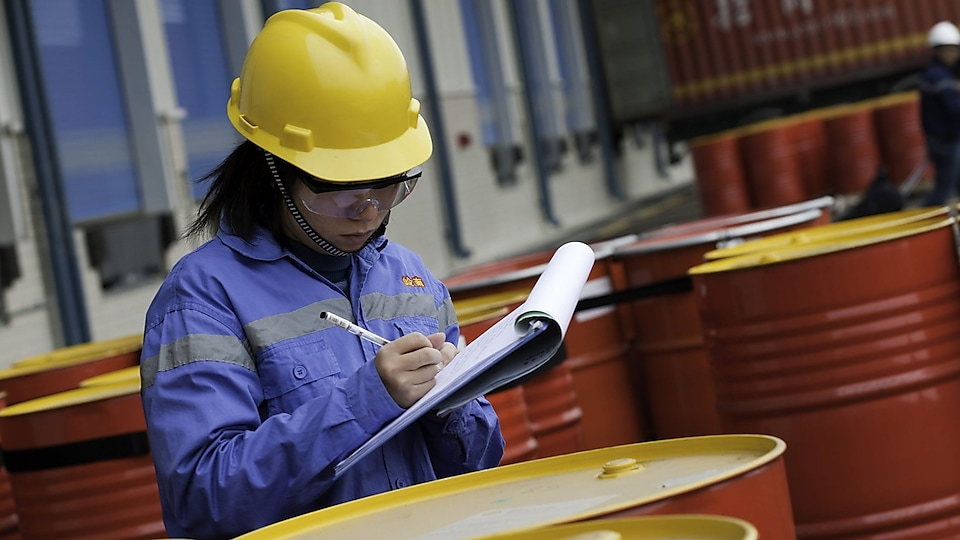 Shell female technician verifying samples