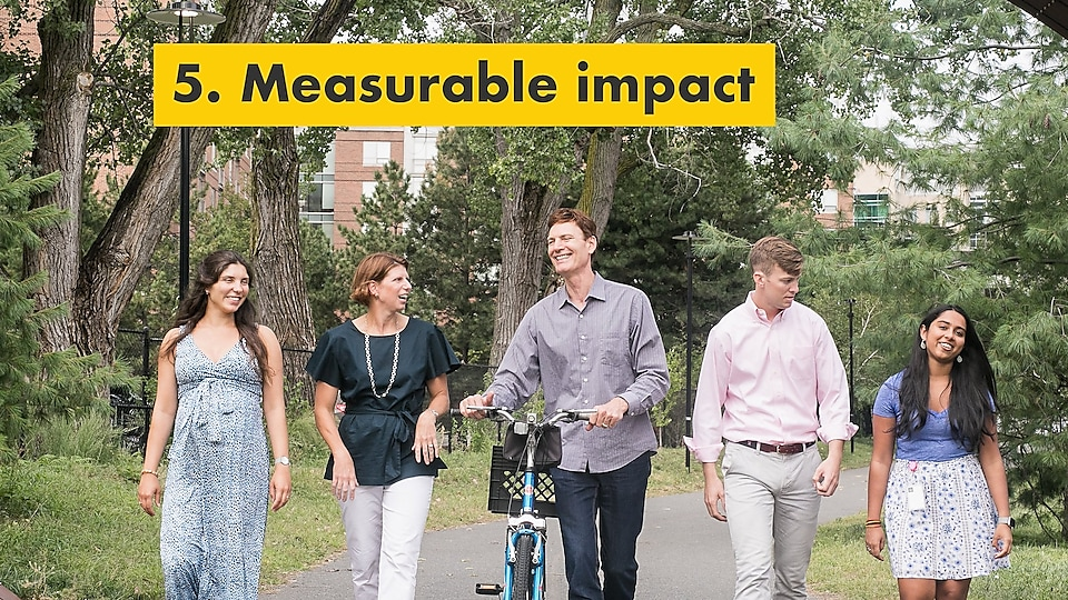 Reason number five – measurable impact. Julie Ferland and Shell TechWorks team taking a walk outdoors.