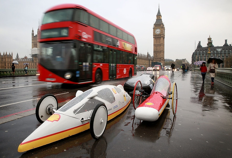 EDITORIAL USE ONLY 5 futuristic hyper-efficient cars, designed by students from the UK for the Shell Eco-marathon – a competition to see how far the vehicles can travel on 1 litre of fuel, drive over Westminster Bridge in London to mark its arrival to the UK. PRESS ASSOCIATION Photo. Picture date: Wednesday November 4, 2015. This year's event is going beyond the student competition by launching 'Make the Future', a public festival to raise greater awareness of the wider energy challenge faced by the UK. The festival will be taking place at London's Queen Elizabeth Olympic Park from June 30 to July 3 2016. Photo credit should read: Matt Alexander/PA Wire