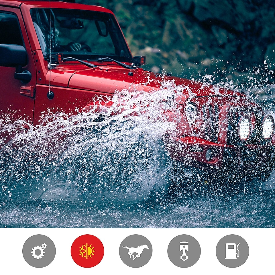 Image of a red jeep driving through a river