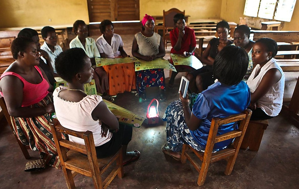 A meeting where women learn how to light their homes